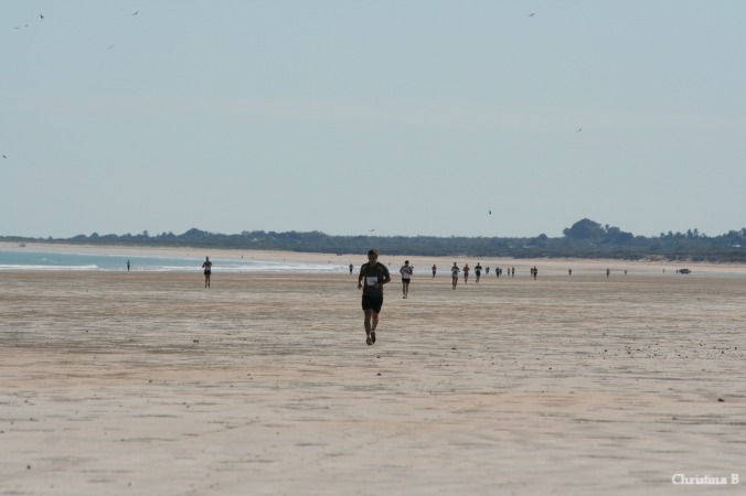 Runners spread out along Cable Beach in the Broome Marathon