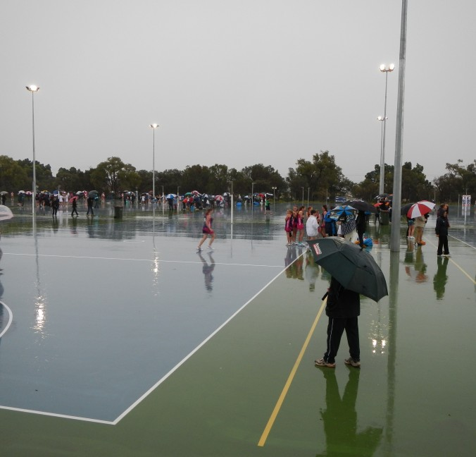 Dedicated supporters on a very wet and stormy netball semi-final day