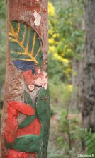 Half Man-made (Pole with Aboriginal Art) and Half Nature (Wattle tree and flowers) (Also Half Focussed and Half Blurry)
