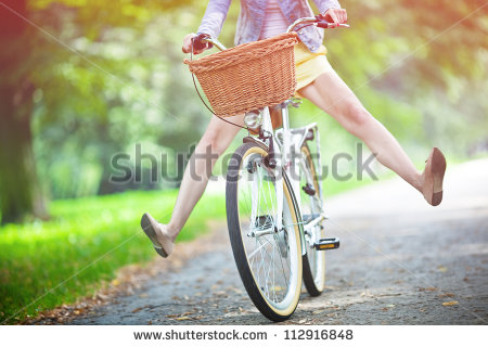stock-photo-woman-riding-bicycle-with-her-legs-in-the-air-112916848