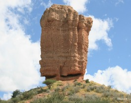 Rock Finger in northwest Namibia measuring 35 metres tall and standing on a hill. It's made of sandstone conglomerate and remained after the surrounding Ugab Terrace washed away thousands of years ago.