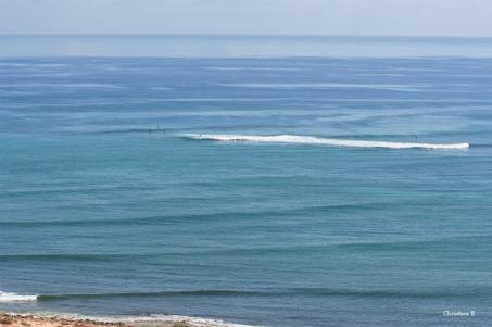 Surfers near Exmouth, northwest WA