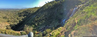 My attempt at a panorama with my iPhone. Pity about the light. Lesmurdie Falls with view towards Perth city and the coast.